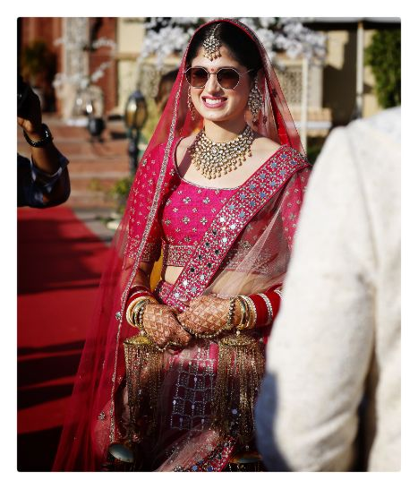 cool bride wearing sunglasses to her wedding