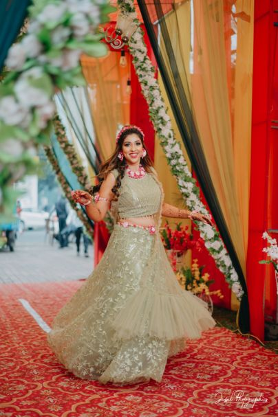twirling bride | bridal outfit for mehendi day |