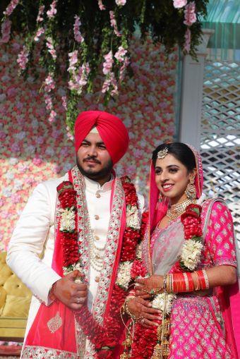 candid indian wedding photography   Pink Anita Dongre Lehenga
