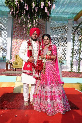 punjabi wedding   groom outfit   Pink Anita Dongre Lehenga