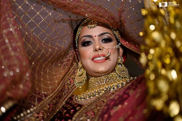 indian bridal photography | veil shot ideas | Sabyasachi Lehenga in Maroon