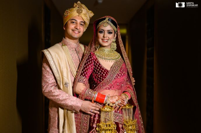 couple photography ideas | couple shoot | Sabyasachi Lehenga in Maroon