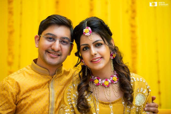 indian couple at their haldi ceremony |