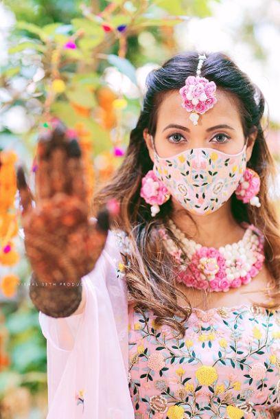 mehendi , indian wedding , indian bride , red lheenga , sabyasachi lehenga , quarantine wedding | bridal mask | wedding outfits
