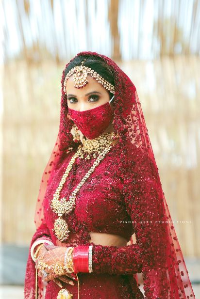 indian wedding , indian bride , red lheenga , sabyasachi lehenga , quarantine wedding | bridal mask | wedding outfits