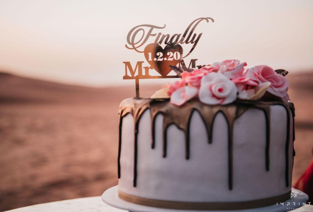 cake , wedding cake , indian wedding , destination wedding in india , red lehenga , bridal details ,  Sabyasachi lehenga | wedding in Abu Dhabi|