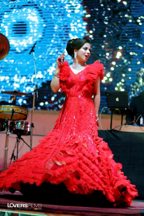 """indian bride , indian bridal gown , weddings , """"red gown , gown with ruffles"""