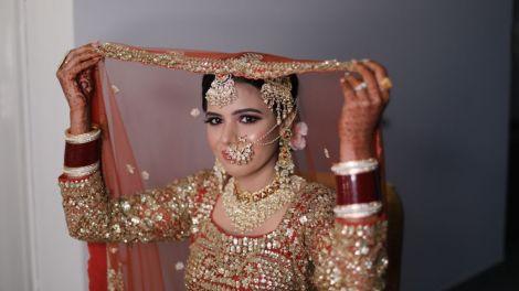 indian wedding , lehenga , orange lehenga   full sleeves blouse   goat work