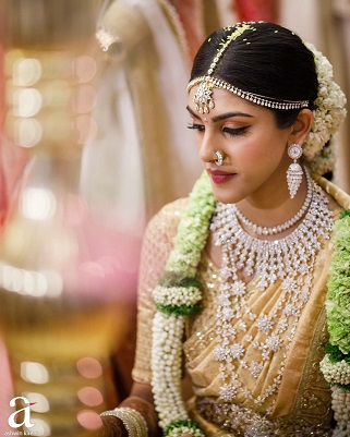 South Indian bride in Golden saree and Diamond necklaces