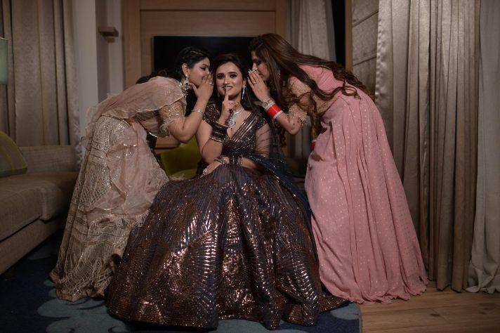 indian bridesmaid , real indian wedding , delhi wedding , curls , lehenga , bridal lehenga ,  punjabi bride | cocktail outfit|