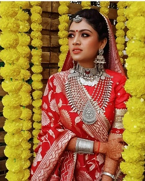 Beautiful bride in red paired with traditional Silver jewellery
