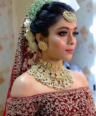 Indian Bride in off-shoulder blouse and Kundan necklace for her wedding