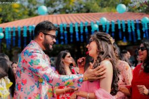 pool party attire - groom in a printed pink sherwani | floral jacket in pink