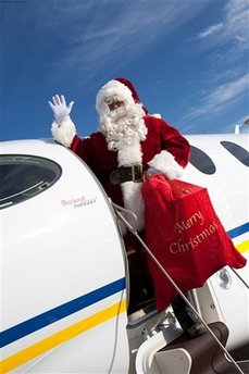 Santa Claus to fly on Beechcraft Premier IA - the world's largest, fastest single-pilot business jet - to spread holiday cheer to military families. (PRNewsFoto/Hawker Beechcraft Corporation)