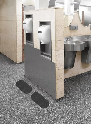Black WizKid Antimicrobial Sink And Dryer Mat Installed Below Hand Dryer In Public Restroom