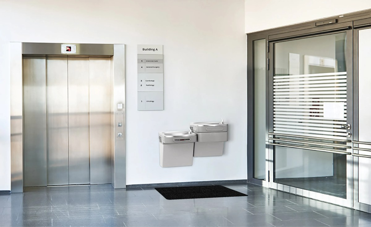 Drinking Fountain With WizKid Products Antimicrobial Runner Mat Below Drinking Fountain In Office Building