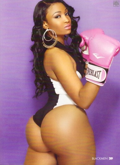Kyra-Chaos-showing-off-her-phat-ass-in-black-and-white-lingerie-while-wearing-pink-boxing-gloves-in-her-shoot-with-BlackMen-Magazine