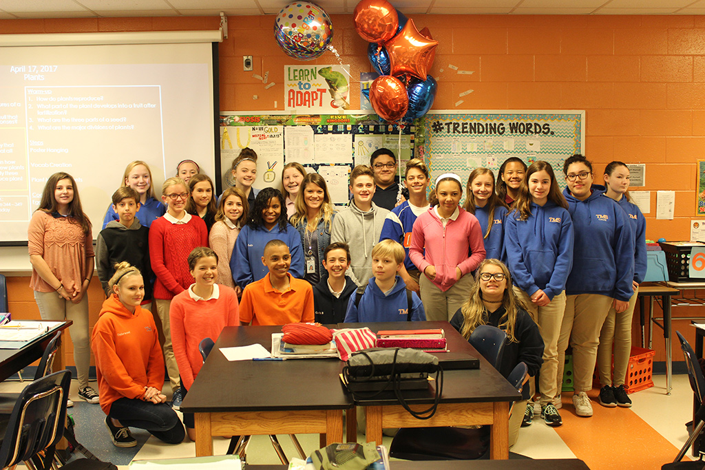 Middle School Teacher of the Year with students