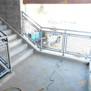 Stair BS-2 handrails. Open area will be glass