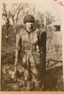 Ed Burke in France after wearing the same uniform for months. That's a thermite grenade on his belt - powerful enough to destroy a tank.