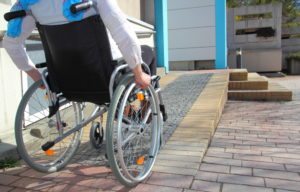 disabled person confined to a wheelchair