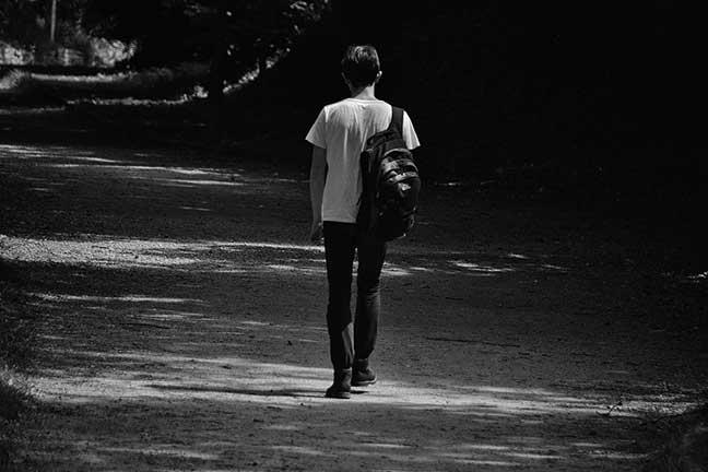 Boy walking to park
