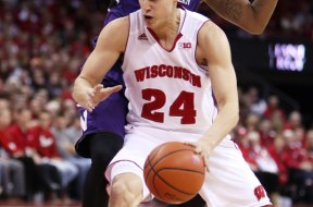 Wisconsin guard Bronson Koenig (24) spins on Northwestern guard JerShon Cobb at the Kohl Center. PHOTO: Mary Langenfeld (USA TODAY)