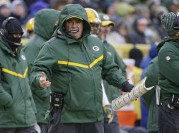 Packers Mike McCarthy raincoat AP