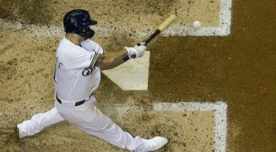 Brewers Mike Moustakas swing AP