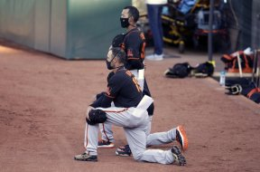 MLB Giants kneeling AP