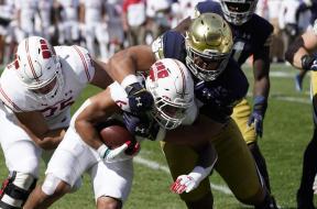 Notre Dame tackle Badgers Mellusi AP