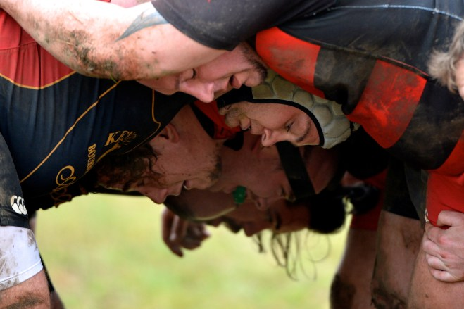 Two teams clash turning a scrum in the Nah Bash rugby tournament.