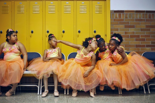 A group of La'Nita School of Dance members wait impatiently in the hallway of Shawnee High School before performing a routine during the annual Father's Day dance recital.