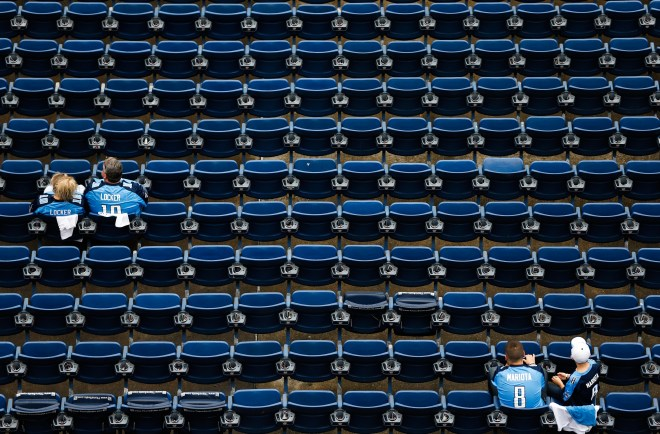 Fans wait for the start of an NFL football game between the Tennessee Titans and the Indianapolis Colts on Sunday, September 27, 2015, in Nashville, Tennessee. WESTON KENNEY