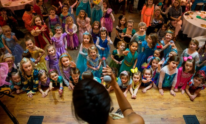 """In excitement, little princesses crowded the stage as Ryelee Robinson, dressed up as Pocahontas, sang """"Colors of the Wind,"""" at Christ Episcopal Church on Sunday, February 21, 2016. This event was held by Bowling Green High School students to raise funds for the school's choral activities.  Weston kenney"""