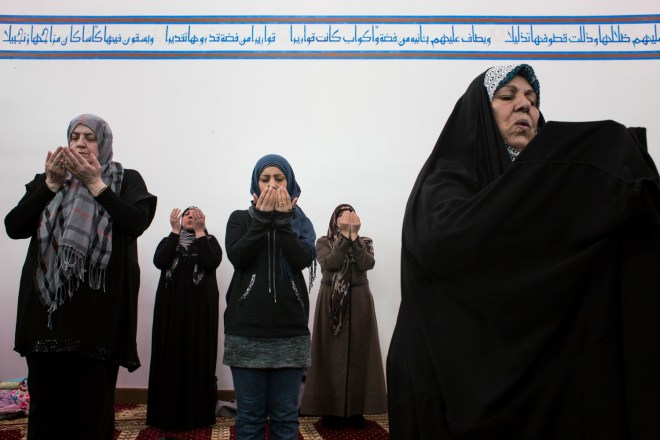 Detroit, Michigan - March 4, 2016: Members of the congregation lift their hands in prayer during a noon service at the Az-Zahra Islamic Center in Detroit, Mich., on Friday, March 4, 2016. Az-Zahra's imam, a prayer leader, Hassan Qazwini, used the service as an opportunity to discuss voting and his view of Republican Presidential Candidate Donald Trump, who he said he believes is unfit to be president.