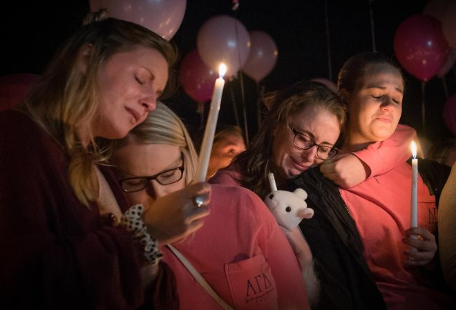 "From left to right, Hayley Hoback, Izzy Rager, Morgan Goetz and Rachel Shipp lean on one another at a vigil to memorialize their Alpha Gamma Delta sister, Stephanie Campbell, on Wednesday, Sept. 28 at the AGD sorority house. Campbell passed away Sunday, Sept. 25 as a result of a single-car accident on the Western Kentucky Parkway. ""She has tattooed on her foot 'You can breathe,'"" remembered Hayley Hoback at the vigil. ""And that's what I can say to her. 'You can breathe now.' She's in a better place now.Ó 