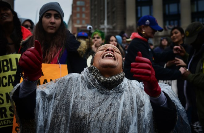 "Terry Perry, an anti-Trump protestor from Pa., dances to a cover of Michael Jackson's ""Man in the Mirror"" during the ANSWER Coalition's protest of Donald Trump's inauguration."