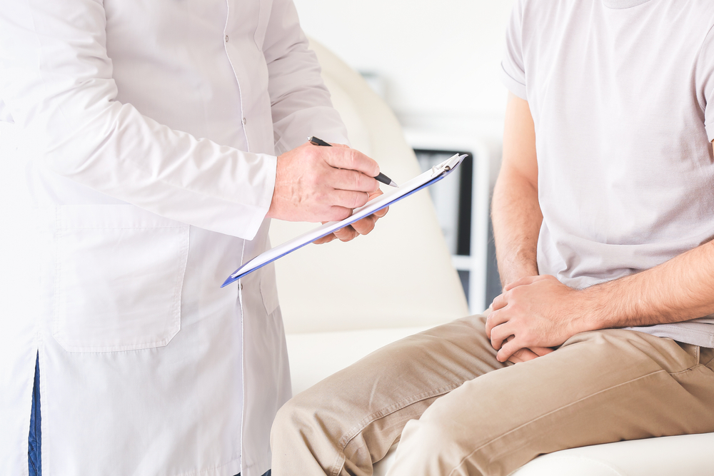 man talking with urologist at appointment
