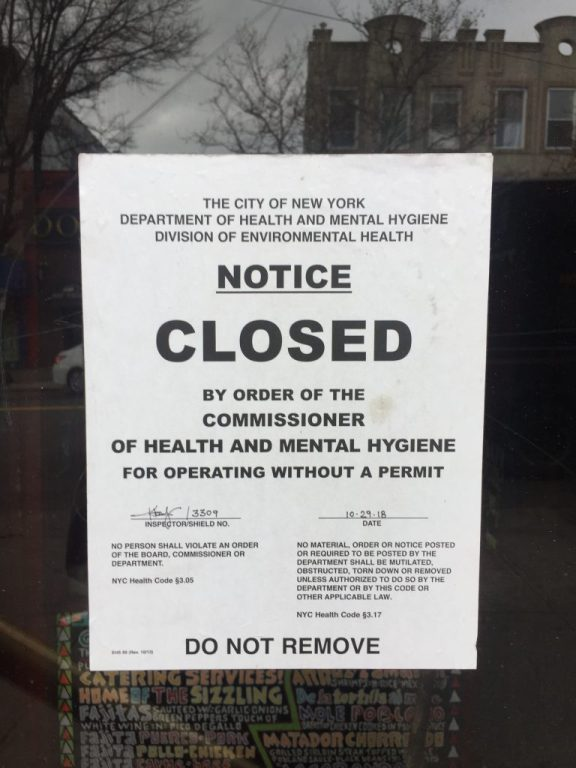 "Sticker on Restaurant door ""CLOSED by order of the Commissioner of Health and Mental Hygiene"""