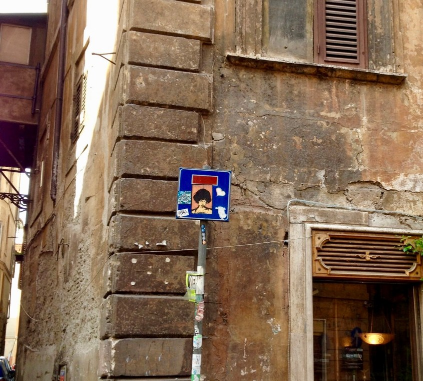 A corner in Rome: Sickers on a sign, which the Angry woman rules #Rome #streetArt #sticker (Not much grafitti in old city Rome)