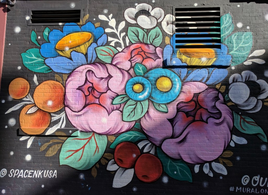 a whole wall Mural of a bouquet on black