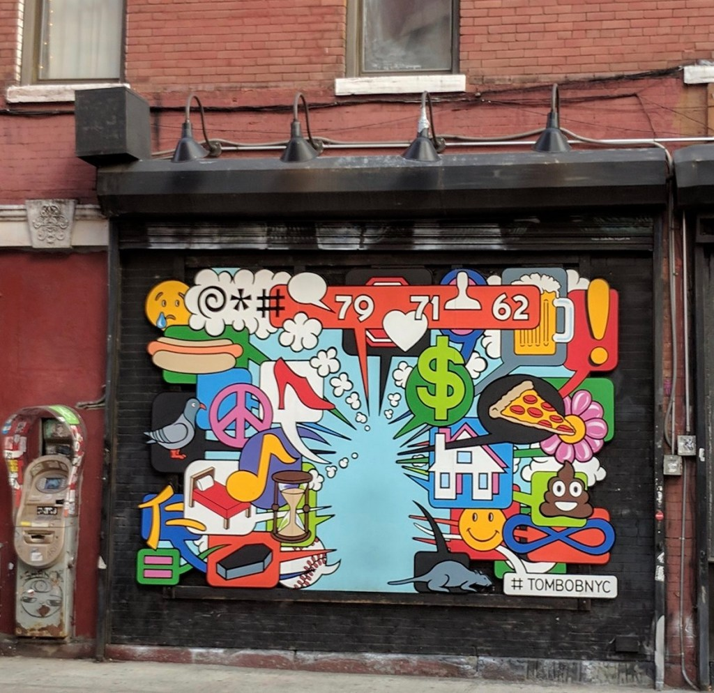 Mural on a bricked up entrance to who knows what covered with comic book Thought, exlaimation and speach ballons about life, death and highheels (Plus emojis)