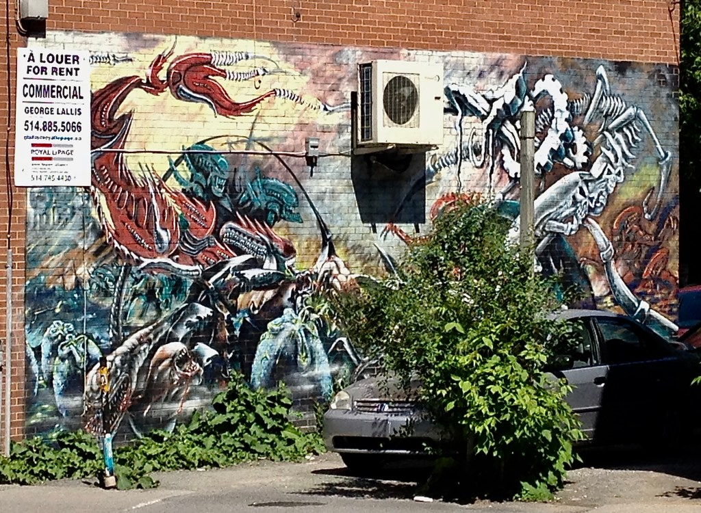 Alien War Wall Background to a parking lot.