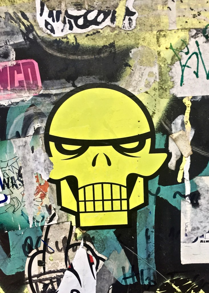 Example of layers of stickers making things cluttered and messy: Yellow Skull with clutter