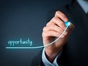 Increase opportunity concept. Businessman draw line to increase opportunity for his company.