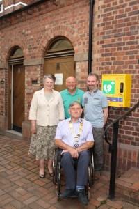 Defibrillator outside Ironbridge Public Toilets - Christine Christian, John Marsh, May Clowes, Ryan Kennedy portrait