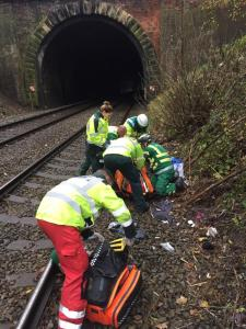 STAFF USE TRAIN, AMBULANCE & HELICOPTER TO TRANSPORT MAN 3