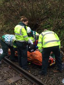 STAFF USE TRAIN, AMBULANCE & HELICOPTER TO TRANSPORT MAN 4