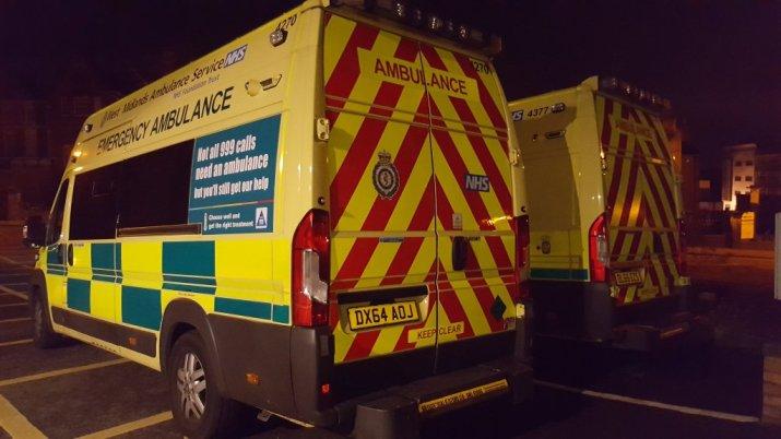 Two ambulances at night